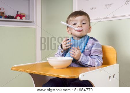 Cute Toddler Eating Yoghurt