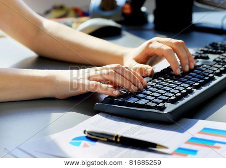 female learner typing on the keyboard