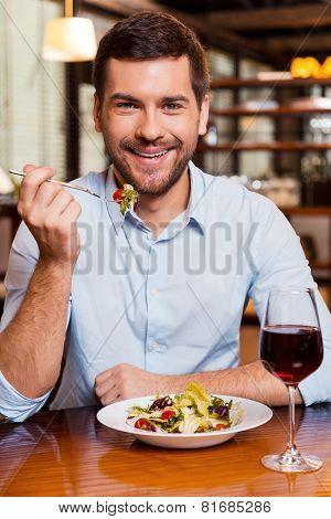 Enjoying Meal At The Restaurant.