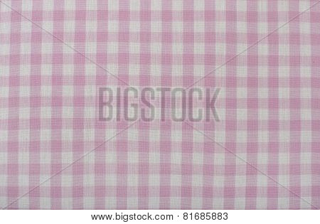 Closeup on checkered tablecloth fabric.