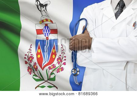 Concept Of Canadian Healthcare System - Yukon province flag on background