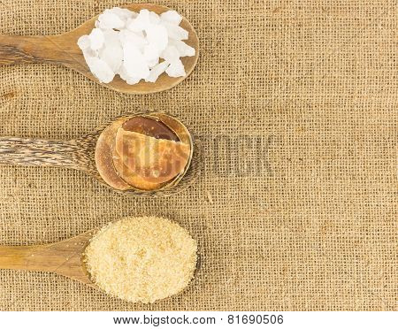 Top View Of  Sugar  On Brown Texture