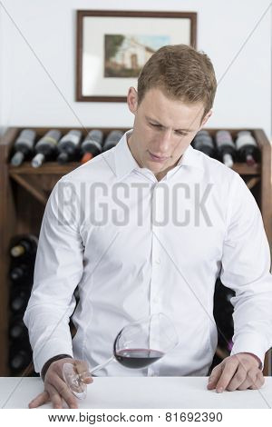 Man Analyzing A Wine Glass