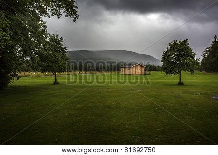 Moody cabin in an empty field