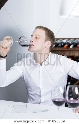 Winemaker Tasting A Red Wineglass.