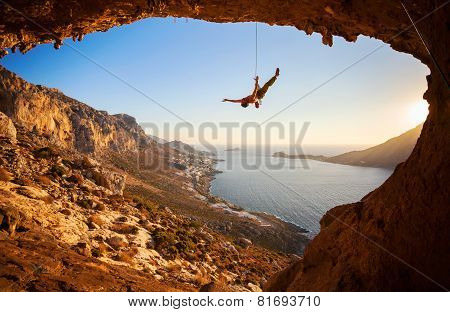 Silhouette of a rock climber falling of a cliff