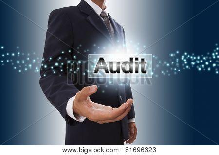 Businessman hand showing audit button
