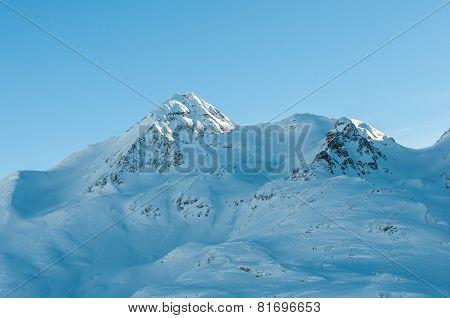Alpine Alps mountain landscape along the Bernina Express. Beautiful winter view on sunny day.