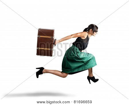Women runs with suitcase