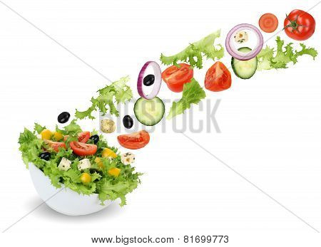 Flying Green Salad In Bowl With Tomatoes, Onion, Olives And Cucumber