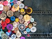 pic of denim jeans  - sewing buttons on denim jeans background texture - JPG