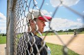pic of  practices  - Teen boy on sidelines at baseball practice - JPG