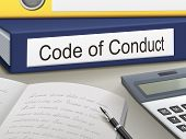 stock photo of conduction  - code of conduct binders on the office table - JPG