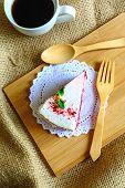 pic of red velvet cake  - Close up of raspberry Red velvet cake on sackcloth with shadows  - JPG