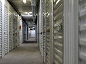 stock photo of self-storage  - Interior hallway in a self storage unit facility - JPG