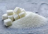 picture of sugar  - white granulated sugar and refined sugar on a gray background - JPG