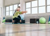 stock photo of personal assistant  - Senior woman doing exercise with her personal trainer at gym - JPG