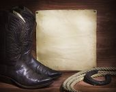 picture of lasso  - cowboy background with American boots and lasso and paper for text - JPG