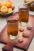 stock photo of cold drink  - Bolivian drink called Mocochinchi made out of dried peeled peach called quisa or kisa sugar and cinnamon - JPG