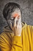 foto of sinus  - Adult Man with Chronic Sinus Headache Wearing Yellow Jacket conceptual image with selective desaturation - JPG