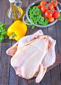 image of gobbler  - raw chicken and fresh vegetables on a table - JPG
