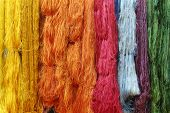 foto of silk worm  - Colorful raw silk thread in the silk farm - JPG