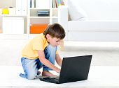 Child Playing On Laptop At Home
