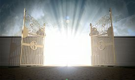 stock photo of gate  - A depiction of the pearly gates of heaven open with the bright side of heaven contrasting with the duller foreground - JPG
