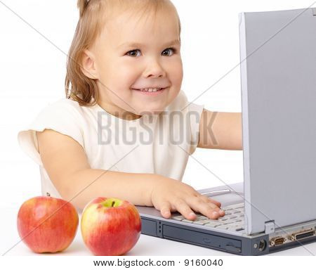 Cute Happy Girl With Laptop And Two Apples