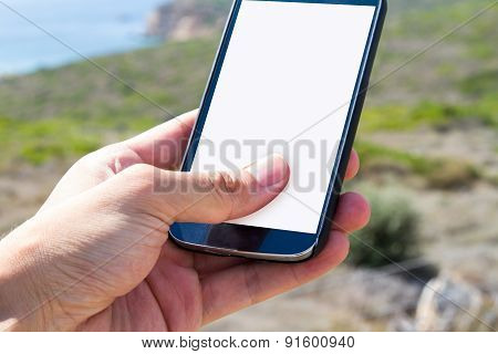 Hand Holding Smart Phone In Nature