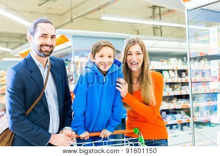 Family with shopping cart in grocery store