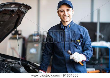 Mechanic working on a car engine