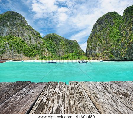 Beautiful lagoon and old wooden pier at Phi Phi Ley island