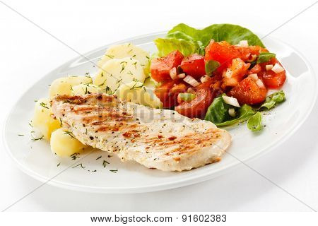 Grilled chicken fillet, boiled potatoes and vegetable salad