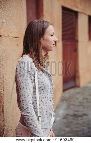 Fashion portrait of young trendy woman outdoors
