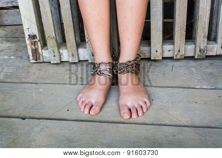 Foot a little Child in chains