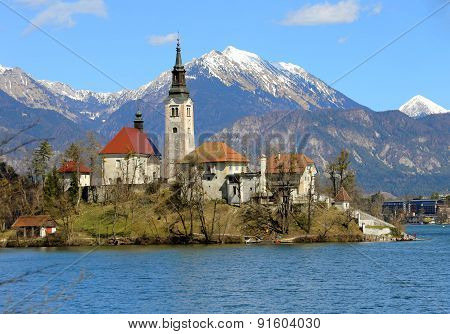 Church On The Island Of Lake Bled In Slovenia And The Snowy Mountains
