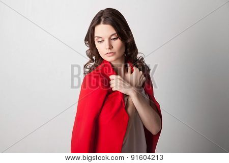 Young beautiful woman holding red jacket