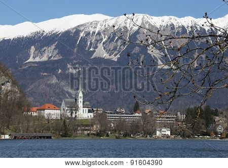 Church With Bell Tower On The Shore Of Lake Bled In Slovenia