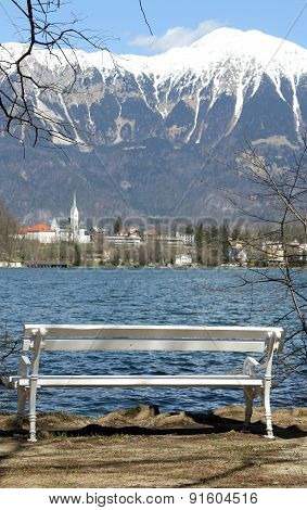 White Bench On The Shore Of Beautiful Lake Bled