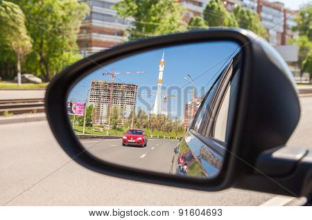 Reflection In The Rearview Mirror Of A Car