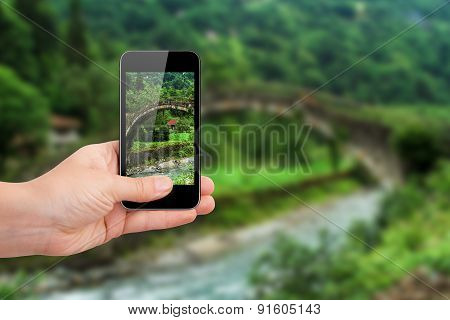 Smart Phone Focused On Landscape Of Plateau