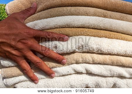 Stack of white  and brown plush towels