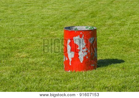 Garbage can on a green lawn