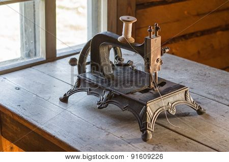 Old Vintage Sewing Machine On Wooden Table