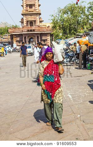 Woman Carrys Goods On The Shoulder At The Sadar Market At The Clocktower
