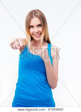 Happy woman hitting camera over gray background. Looking at camera
