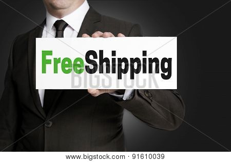 Free Shipping Sign Is Held By Businessman