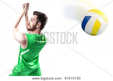 Volleyball player on green uniform on white background