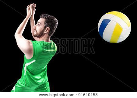 Volleyball player on green uniform on black background